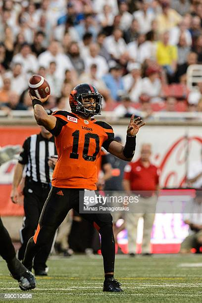Quarterback Jonathon Jennings of the BC Lions looks to play the ball during the CFL game against the Montreal Alouettes at Percival Molson Stadium on...