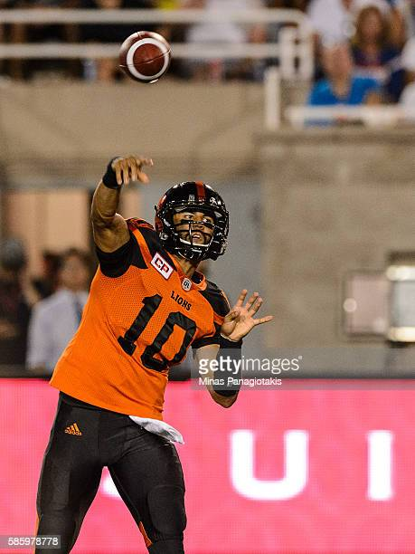 Quarterback Jonathon Jennings of the BC Lions plays the ball against the Montreal Alouettes during the CFL game at Percival Molson Stadium on August...