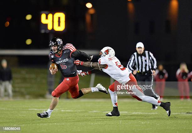 Quarterback Jordan Lynch of the Northern Illinois Huskies eludes cornerback Eric Patterson of the Ball State Cardinals on his way to a 16yard run...