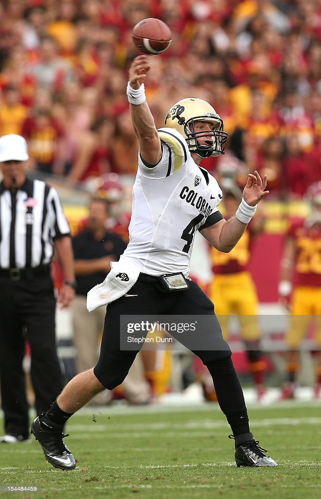 Quarterback Jordan Webb #4 of the Colorado Buffaloes throws a pass against the USC Trojans at the Los Angeles Memorial Coliseum on October 20,2012 in Los Angeles, California.