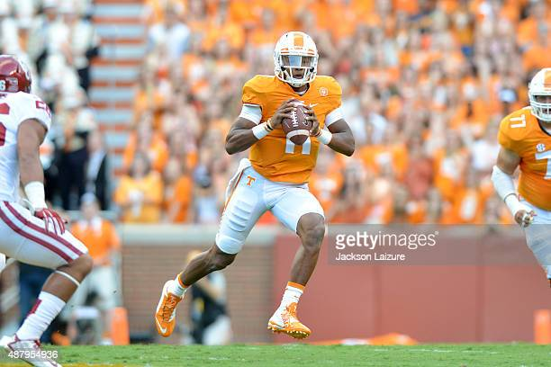 Quarterback Josh Dobbs of the Tennessee Volunteers gets chased out of the pocket during the first half of their game against the Oklahoma Sooners at...