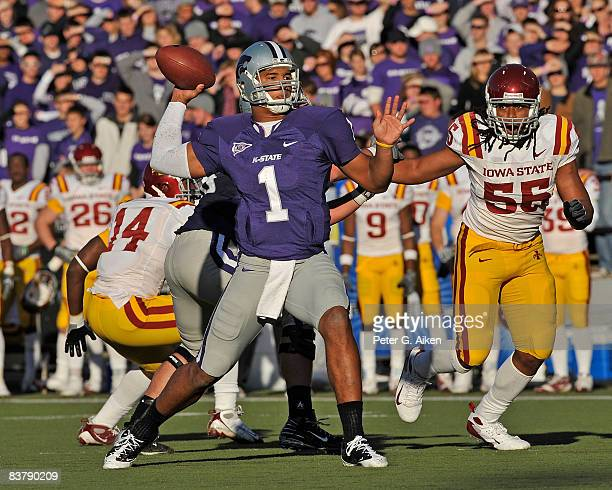 Quarterback Josh Freeman of the Kansas State Wildcats throws the ball down field under pressure from defensive end Christopher Lyle of the Iowa State...