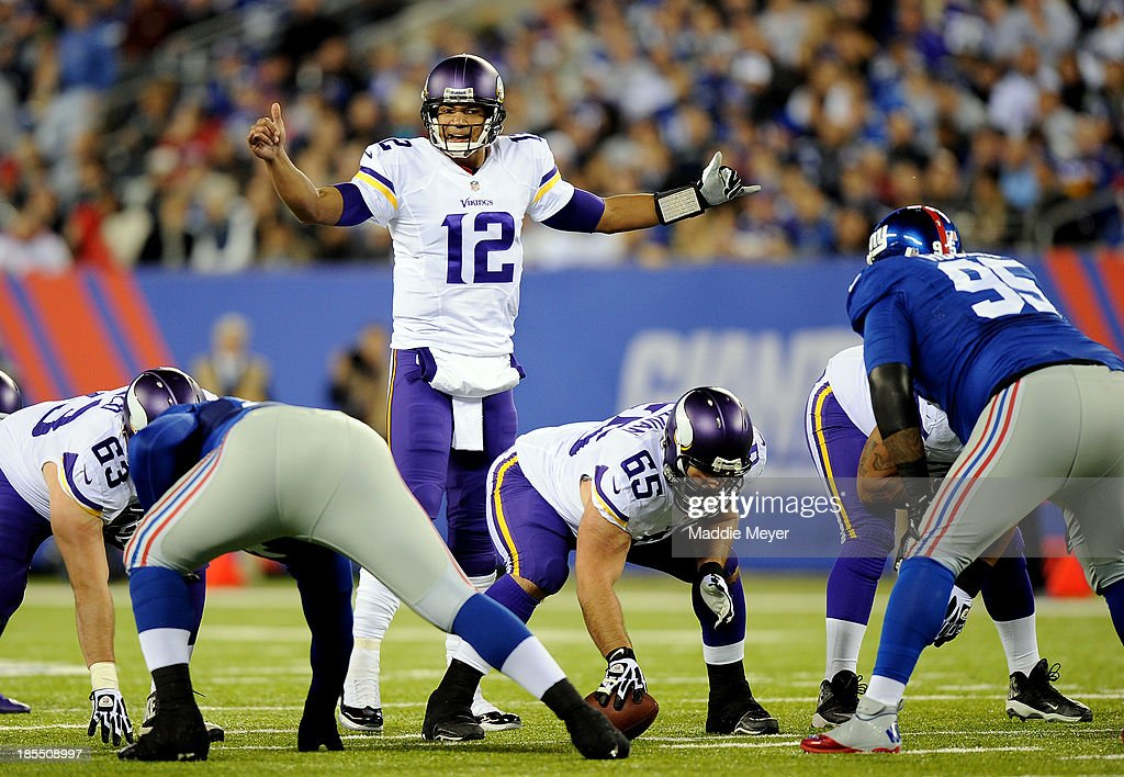 Quarterback Josh Freeman #12 of the Minnesota Vikings calls a play against the New York Giants during a game at MetLife Stadium on October 21, 2013 in East Rutherford, New Jersey.