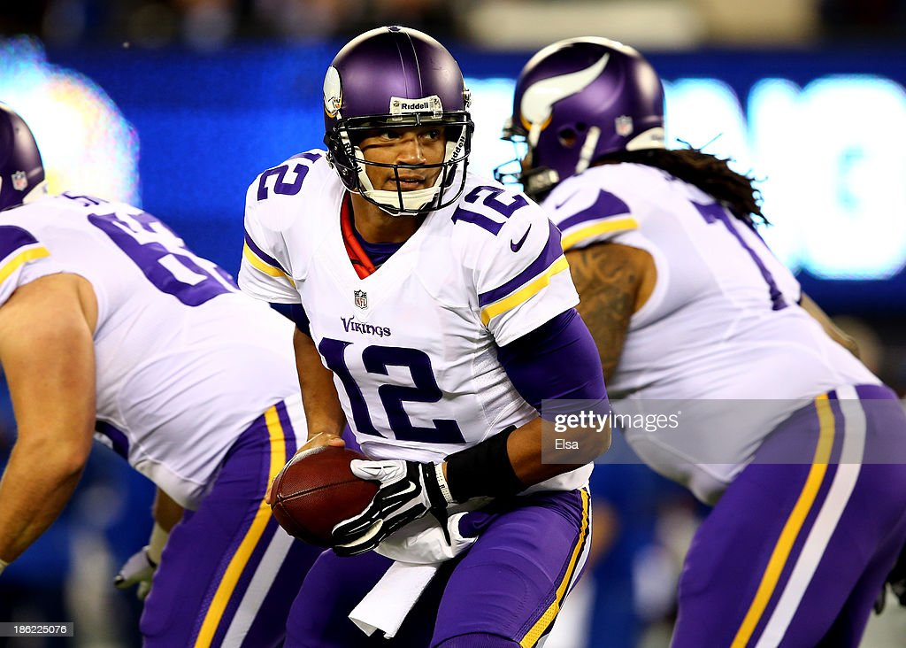 Quarterback <a gi-track='captionPersonalityLinkClicked' href=/galleries/search?phrase=Josh+Freeman&family=editorial&specificpeople=4036797 ng-click='$event.stopPropagation()'>Josh Freeman</a> #12 of the Minnesota Vikings looks to hand the ball off against the New York Giants during a game at MetLife Stadium on October 21, 2013 in East Rutherford, New Jersey.