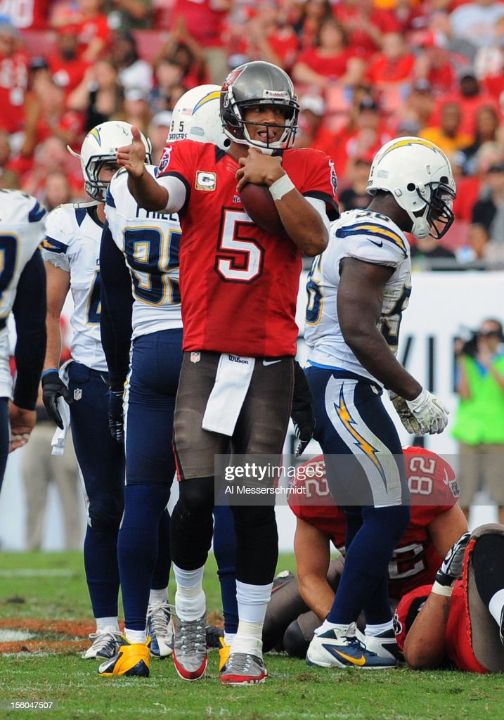 Quarterback <a gi-track='captionPersonalityLinkClicked' href=/galleries/search?phrase=Josh+Freeman&family=editorial&specificpeople=4036797 ng-click='$event.stopPropagation()'>Josh Freeman</a> #5 of the Tampa Bay Buccaneers celebrates after running for a first down against the San Diego Chargers November 11, 2012 at Raymond James Stadium in Tampa, Florida. Tampa won 34 - 24.