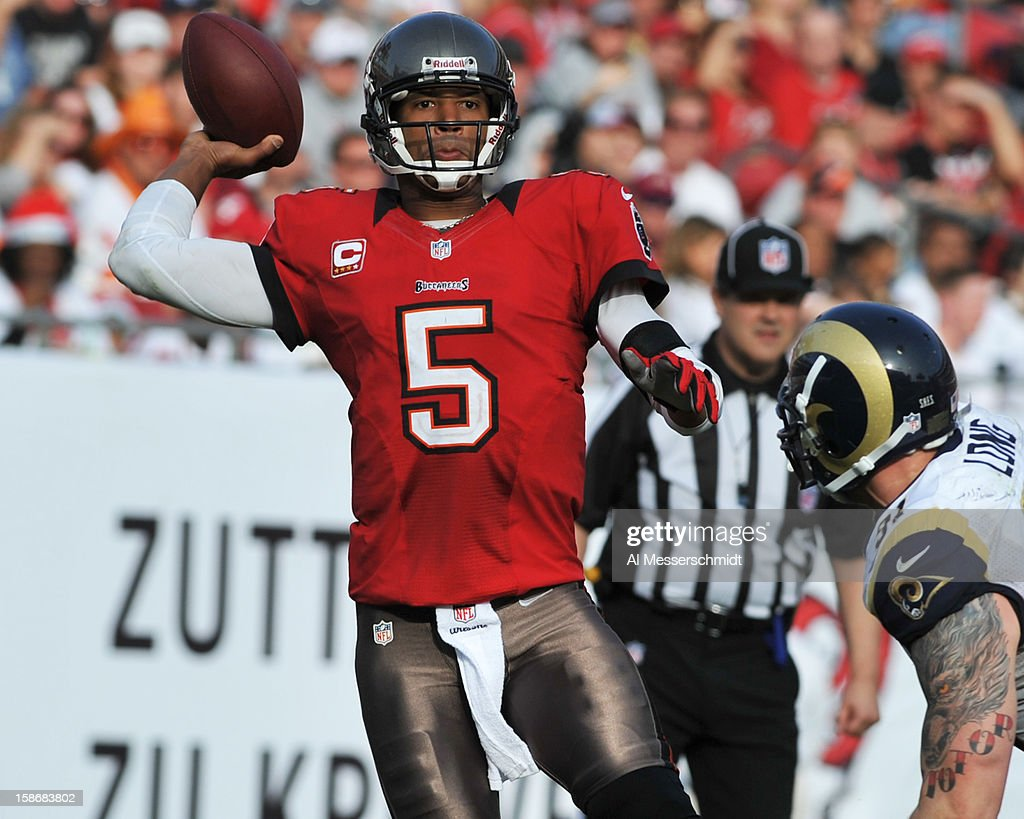Quarterback <a gi-track='captionPersonalityLinkClicked' href=/galleries/search?phrase=Josh+Freeman&family=editorial&specificpeople=4036797 ng-click='$event.stopPropagation()'>Josh Freeman</a> #5 of the Tampa Bay Buccaneers sets to pass against the St. Louis Rams December 23, 2012 at Raymond James Stadium in Tampa, Florida.