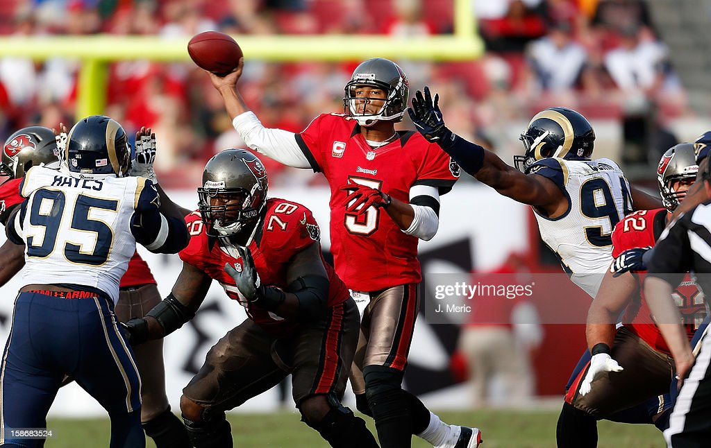 Quarterback <a gi-track='captionPersonalityLinkClicked' href=/galleries/search?phrase=Josh+Freeman&family=editorial&specificpeople=4036797 ng-click='$event.stopPropagation()'>Josh Freeman</a> #5 of the Tampa Bay Buccaneers throws a pass against the St. Louis Rams during the game at Raymond James Stadium on December 23, 2012 in Tampa, Florida.