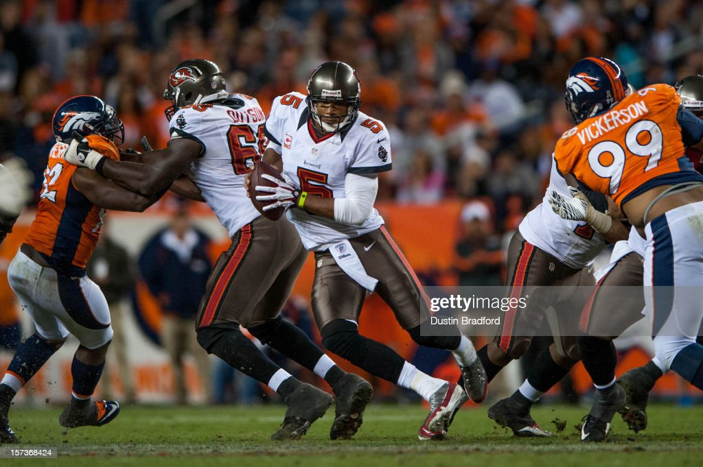 Quarterback <a gi-track='captionPersonalityLinkClicked' href=/galleries/search?phrase=Josh+Freeman&family=editorial&specificpeople=4036797 ng-click='$event.stopPropagation()'>Josh Freeman</a> #5 of the Tampa Bay Buccaneers with a quarterback keep during a game against the Denver Broncos at Sports Authority Field Field at Mile High on December 2, 2012 in Denver, Colorado.
