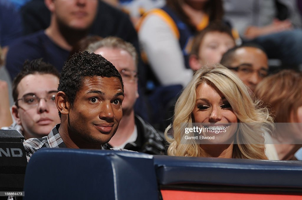 Quarterback <a gi-track='captionPersonalityLinkClicked' href=/galleries/search?phrase=Josh+Freeman&family=editorial&specificpeople=4036797 ng-click='$event.stopPropagation()'>Josh Freeman</a> of the Tampa Bay Bucks and guest attend the game between the Los Angeles Clippers and the Denver Nuggets on January 1, 2013 at the Pepsi Center in Denver, Colorado.