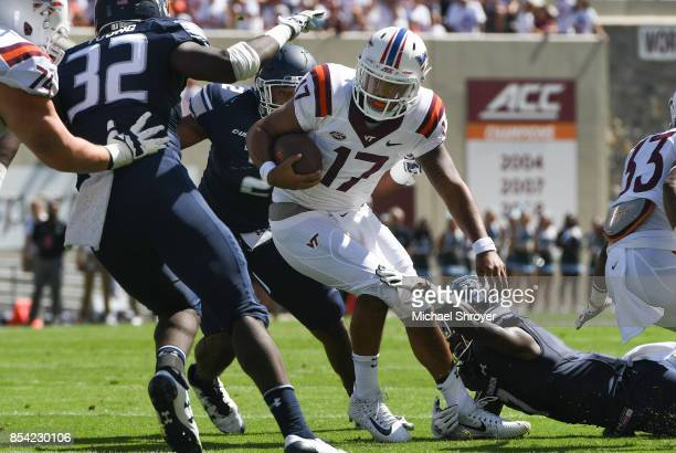 Quarterback Josh Jackson of the Virginia Tech Hokies is hit by cornerback Brandon Addison of the Old Dominion University Monarchs in the first half...