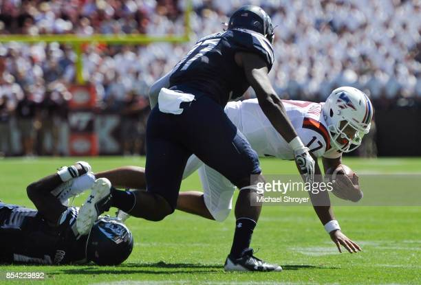 Quarterback Josh Jackson of the Virginia Tech Hokies is tackled by cornerback Brandon Addison of the Old Dominion University Monarchs in the first...