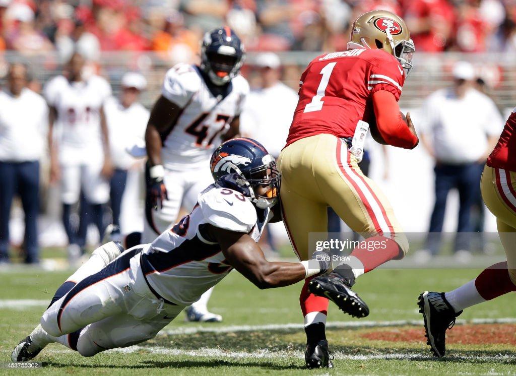 Quarterback Josh Johnson #1 of the San Francisco 49ers runs with the ball against Steven Johnson #53 of the Denver Broncos during a preseason game at Levi's Stadium on August 17, 2014 in Santa Clara, California.