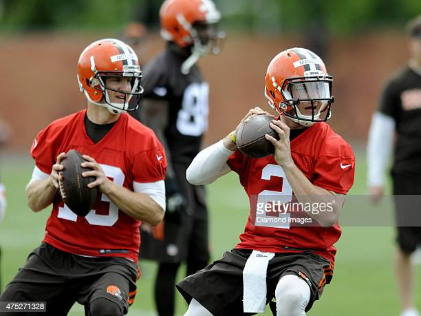 Quarterback Josh McCown and Johnny Manziel of the Cleveland Browns drop back to pass during a mini camp practice on May 26 2015 at the Cleveland...