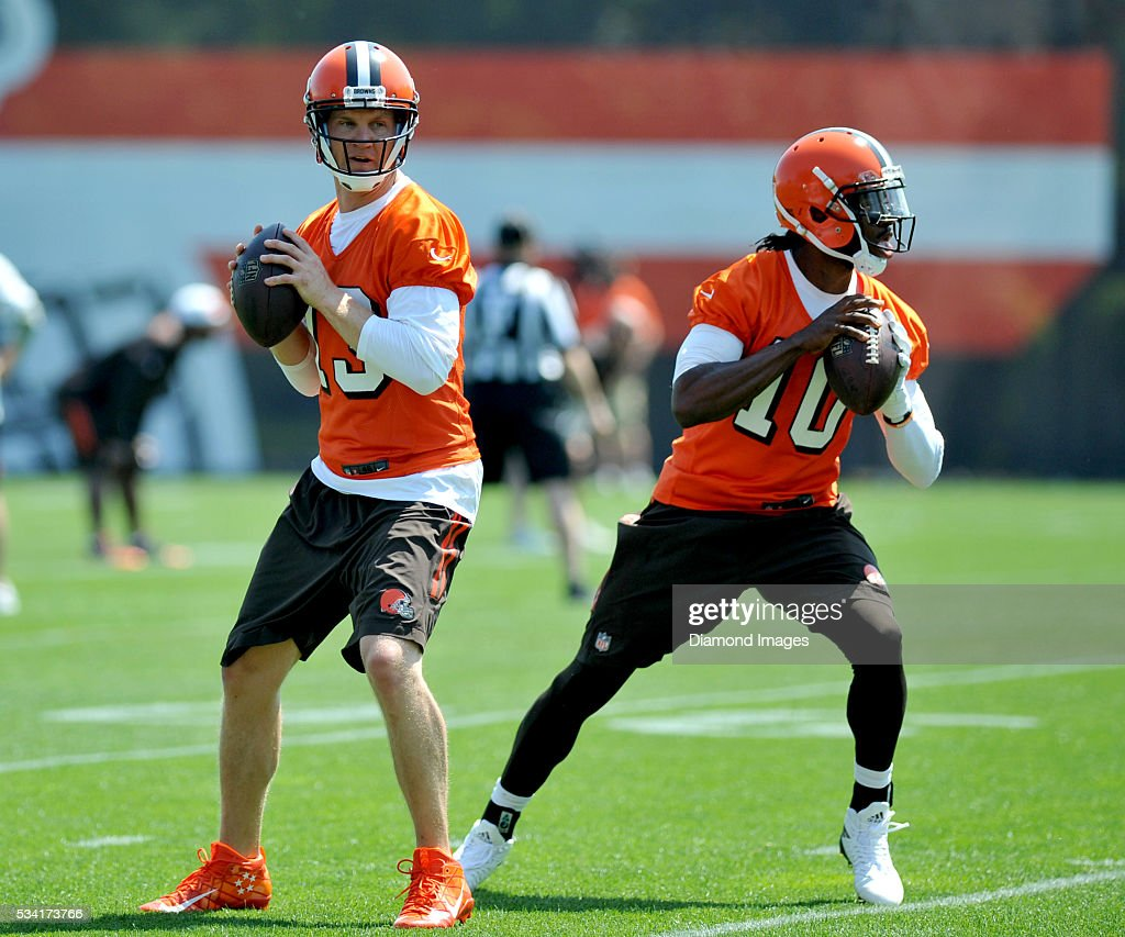 Quarterback <a gi-track='captionPersonalityLinkClicked' href=/galleries/search?phrase=Josh+McCown&family=editorial&specificpeople=182518 ng-click='$event.stopPropagation()'>Josh McCown</a> #13 and <a gi-track='captionPersonalityLinkClicked' href=/galleries/search?phrase=Robert+Griffin&family=editorial&specificpeople=2495030 ng-click='$event.stopPropagation()'>Robert Griffin</a> III #10 of the Cleveland Browns drop back to pass during an OTA practice on May 25, 2016 at the Cleveland Browns training facility in Berea, Ohio.