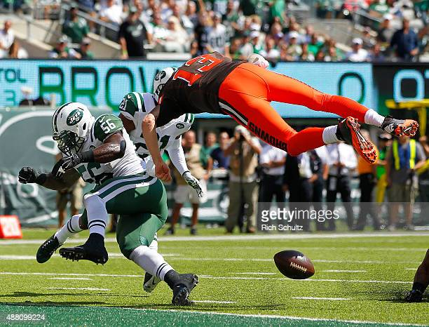 Quarterback Josh McCown of the Cleveland Browns fumbles at the goal line after being hit by Demario Davis of the New York Jets during the first...