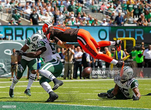 Quarterback Josh McCown of the Cleveland Browns fumbles at the goal line after being hit by Marcus Gilchrist Demario Davis and Calvin Pryor of the...