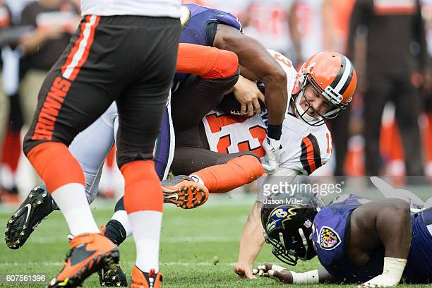 Quarterback Josh McCown of the Cleveland Browns is sacked during the second half against the Baltimore Ravens at FirstEnergy Stadium on September 18...