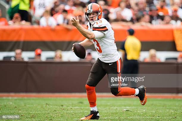 Quarterback Josh McCown of the Cleveland Browns yells to his receiver as he runs out of the pocket during the second half against the Baltimore...