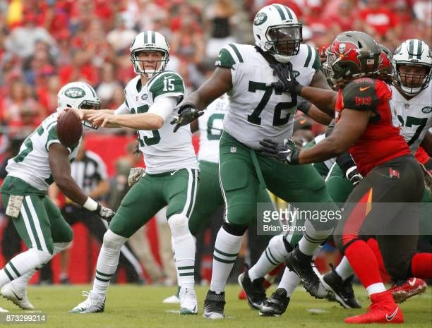 Quarterback Josh McCown of the New York Jets drops back for a pass while getting protection by offensive tackle Brandon Shell from pressure from...