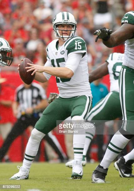 Quarterback Josh McCown of the New York Jets looks for a receiver during the first quarter of an NFL football game against the Tampa Bay Buccaneers...