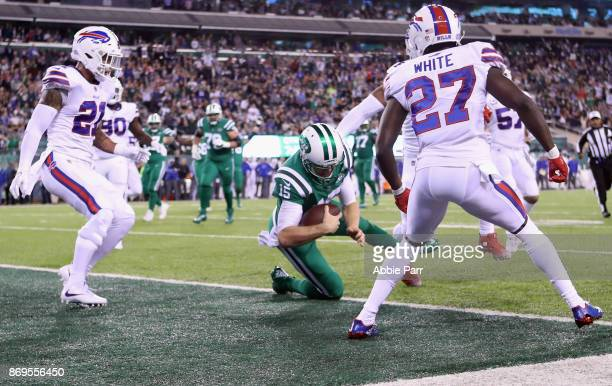 Quarterback Josh McCown of the New York Jets scores a touchdown against cornerback Tre'Davious White and free safety Jordan Poyer of the Buffalo...