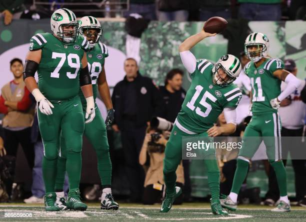 Quarterback Josh McCown of the New York Jets spikes the ball in celebration of scoring a touchdown against the Buffalo Bills during the first quarter...