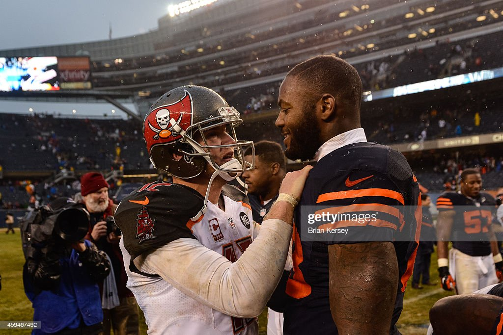 Quarterback Josh McCown #12 of the Tampa Bay Buccaneers talks with tight end Martellus Bennett #83 of the Chicago Bears after the game at Soldier Field on November 23, 2014 in Chicago, Illinois. The Chicago Bears defeat the Tampa Bay Buccaneers 21-13.