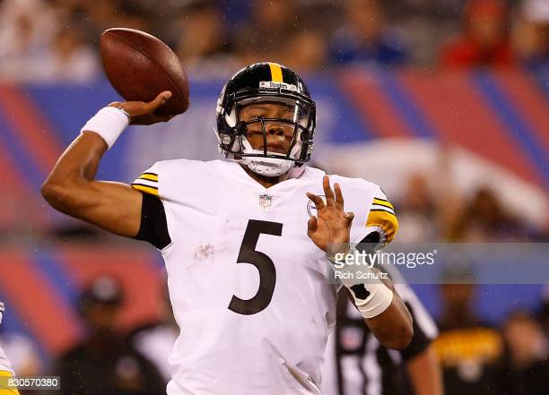 Quarterback Joshua Dobbs of the Pittsburgh Steelers attempts a pass against the New York Giants during the second quarter of an NFL preseason game at...