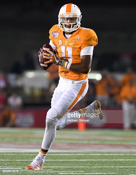 Quarterback Joshua Dobbs of the Tennessee Volunteers looks to pass against the Virginia Tech Hokies in the first half at Bristol Motor Speedway on...