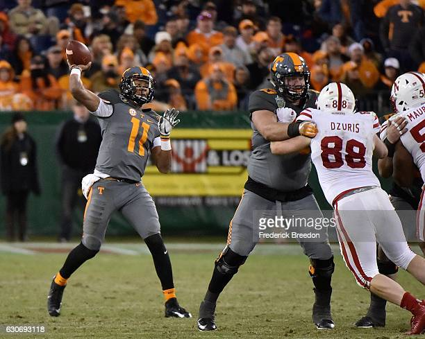 Quarterback Joshua Dobbs of the University of Tennessee Volunteers throws a 59 yard touchdown pass against the Nebraska Cornhuskers during the second...