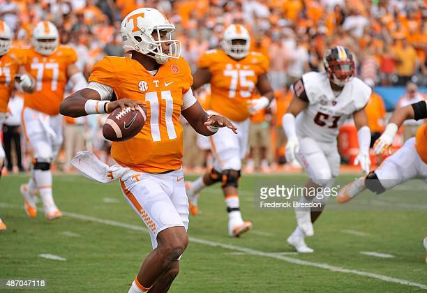 Quarterback Joshua Dobbs of the University of Tennessee Volunteers rolls out to pass against the Bowling Green Falcons during the first half at...