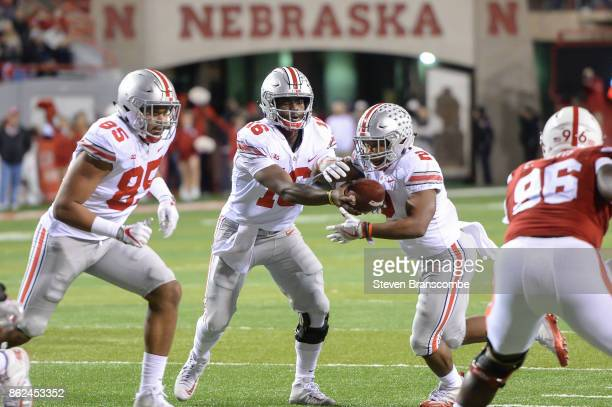 Quarterback JT Barrett of the Ohio State Buckeyes hands off to running back JK Dobbins of the Ohio State Buckeyes against the Nebraska Cornhuskers at...