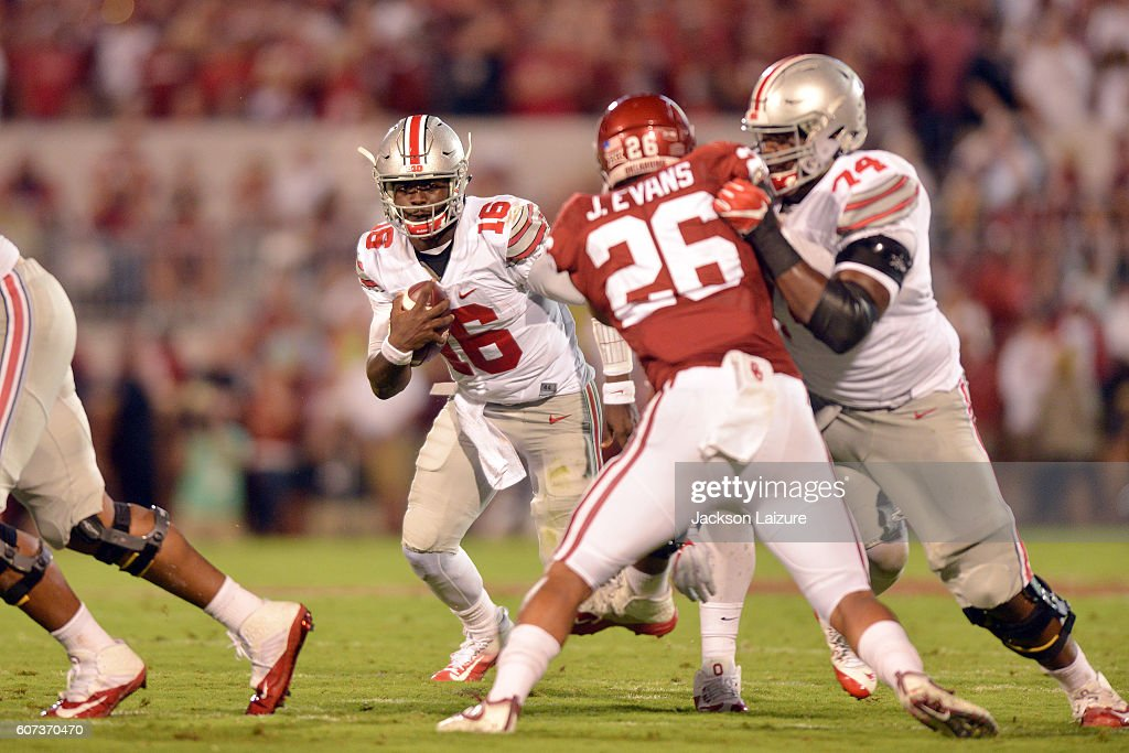 Quarterback J.T. Barrett #16 of the Ohio State Buckeyes looks for running room during the first half of their game against the Oklahoma Sooners on September 17, 2016 at Gaylord Family Oklahoma Memorial Stadium in Norman, Oklahoma.