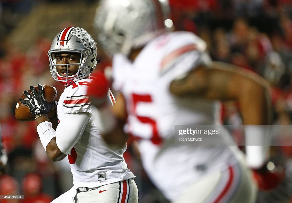 Quarterback J.T. Barrett #16 of the Ohio State Buckeyes looks to pass to Marcus Baugh #85 during the second quarter against the Rutgers Scarlet Knights at High Point Solutions Stadium on October 24, 2015 in Piscataway, New Jersey. Ohio State defeated Rutgers 49-7.