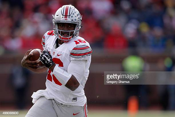 Quarterback JT Barrett of the Ohio State Buckeyes rushes the ball against the Michigan Wolverines in the third quarter at Michigan Stadium on...