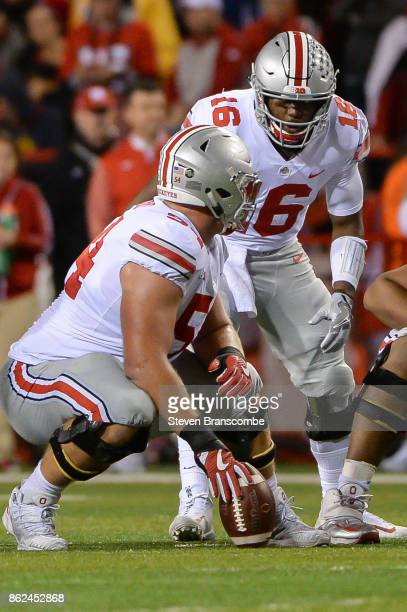Quarterback JT Barrett of the Ohio State Buckeyes talks with offensive lineman Billy Price of the Ohio State Buckeyes against the Nebraska...