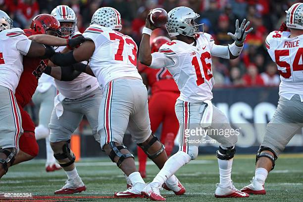 Quarterback JT Barrett of the Ohio State Buckeyes throws a touchdown pass to Curtis Samuel against the Maryland Terrapins during the first quarter at...