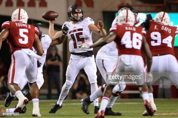 Quarterback Justice Hansen of the Arkansas State Red Wolves passes against the Nebraska Cornhuskers at Memorial Stadium on September 2 2017 in...