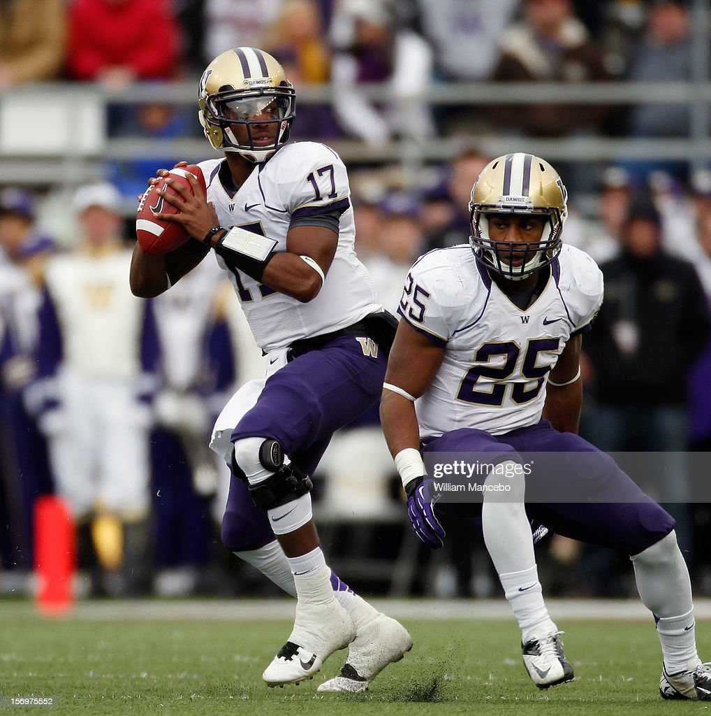 Quarterback Keith Price #17 and Bishop Sankey #25 of the Washington Huskies during the Apple Cup game against the Washington State Cougars at Martin Stadium on November 23, 2012 in Pullman, Washington.