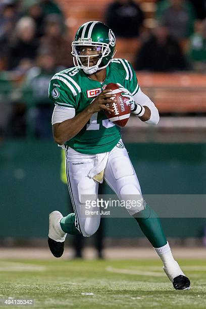 Quarterback Keith Price of the Saskatchewan Roughriders rolls out of the pocket in the game between the Edmonton Eskimos and Saskatchewan Roughriders...
