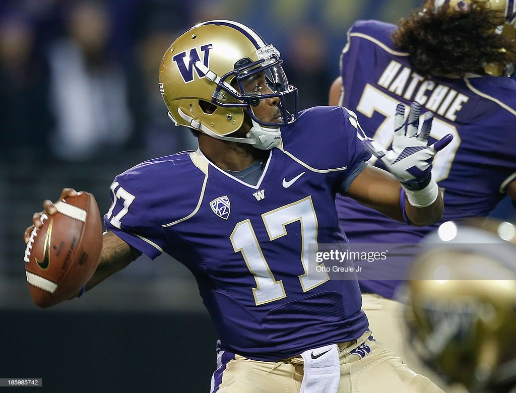 Quarterback Keith Price #17 of the Washington Huskies passes against the California Golden Bears on October 26, 2013 at Husky Stadium in Seattle, Washington.
