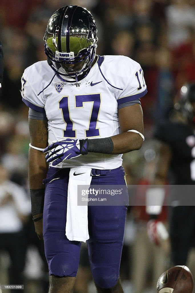 Quarterback Keith Price #17 of the Washington Huskies reacts after a penalty during the second quarter of his game against the Stanford Cardinal on October 5, 2013 at Stanford Stadium in Stanford, California.