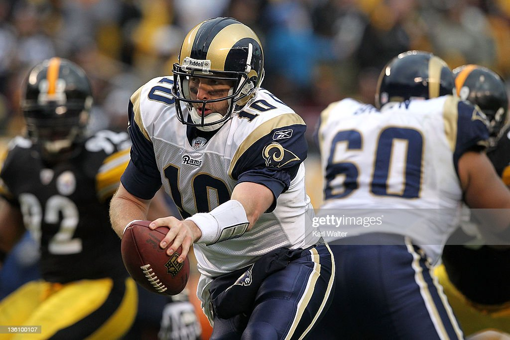 Quarterback <a gi-track='captionPersonalityLinkClicked' href=/galleries/search?phrase=Kellen+Clemens&family=editorial&specificpeople=221591 ng-click='$event.stopPropagation()'>Kellen Clemens</a> #10 of the St. Louis Rams hands off the football during the game against the Pittsburgh Steelers at Heinz Field on December 24, 2011 in Pittsburgh, Pennsylvania.