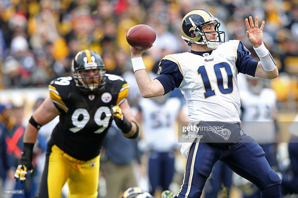 Quarterback Kellen Clemens #10 of the St. Louis Rams is pursued by defensive end Brett Keisel #99 of the Pittsburgh Steelers during the game against the Pittsburgh Steelers at Heinz Field on December 24, 2011 in Pittsburgh, Pennsylvania.