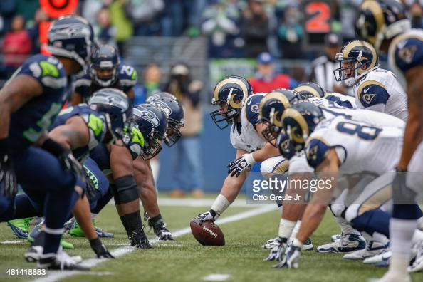 Quarterback Kellen Clemens of the St Louis Rams looks over the defense at the line of scrimmage during the game against the Seattle Seahawks at...