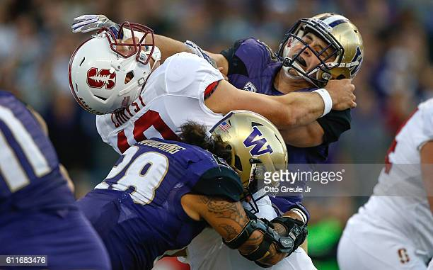 Quarterback Keller Chryst of the Stanford Cardinal is hit as he throws by linebacker Connor O'Brien and linebacker Psalm Wooching of the Washington...