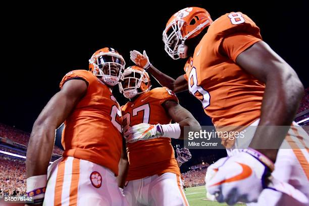 Quarterback Kelly Bryant wide receiver Deon Cain and tight end DJ Greenlee of the Clemson Tigers celebrate following Bryant's touchdown to start the...