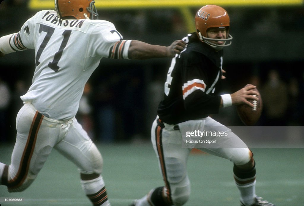 Quarterback Ken Anderson of the Cincinnati Bengals tries to avoid the tackle of Walter Johnson of the Cleveland Browns during an NFL football game...