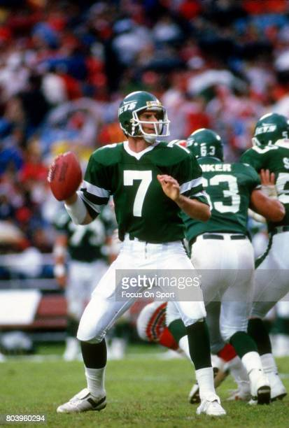 Quarterback Ken O'Brien of the New York Jets drops back to pass against the Atlanta Falcons during an NFL football game November 9 1986 at...