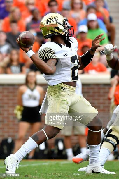 Quarterback Kendall Hinton of the Wake Forest Demon Deacons attempts a pass against the Clemson Tigers during the game at Memorial Stadium on October...